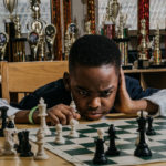 Бездомный 8-летний беженец стал чемпионом Нью-Йорка по шахматам